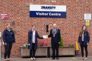 Sally Crawford presents Cllr England with his Womble Sponsorship Certificate